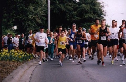 Photo taken in 1999 of large group of men and women of all ages running in a 5k